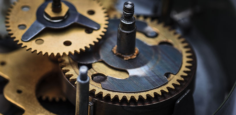 macro view of a clock mechanism representing the importance of time and running like clockwork in business